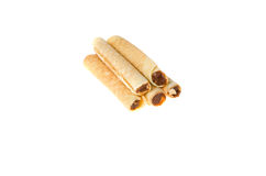 Confection rolls with cooked condensed milk on a white background Royalty Free Stock Photography
