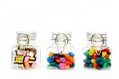Confectionary in glass jar. Sugar coated confectionary in glass jar isolated on white background Stock Image