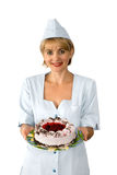The confectioner. Is photographed with a cake Royalty Free Stock Photography
