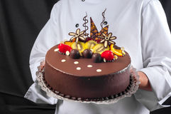 Confectioner and a cake Royalty Free Stock Photo