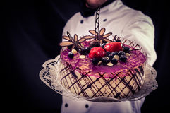 Confectioner and a cake Royalty Free Stock Image