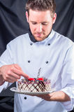 Confectioner and a cake Stock Image
