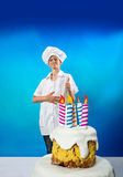 Confectioner with cake Royalty Free Stock Image
