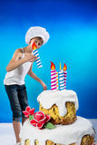 Confectioner with a cake Royalty Free Stock Photos