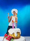Confectioner with a cake Royalty Free Stock Image