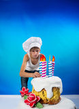 Confectioner with a cake Royalty Free Stock Photo