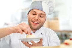 Confectioner with cake royalty free stock photos