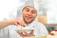 Confectioner with cake Royalty Free Stock Photo