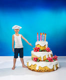Confectioner with a cake Royalty Free Stock Photography