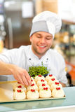 Confectioner with cakes Royalty Free Stock Photo