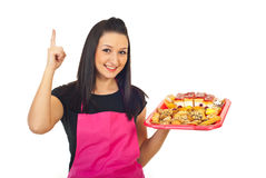 Confectioner with cakes pointing up Stock Photo