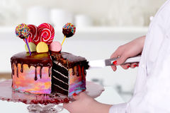 The confectioner cuts cake Stock Photo