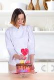 The confectioner decorates cake Stock Photo