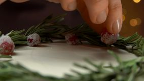 Confectioner decorates the cake with sugar cranberries. And rosemary, view from the top stock video