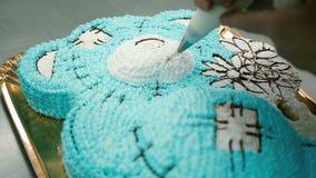 Confectioner decorates a delicious cake stock video
