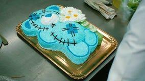Confectioner decorates a delicious cake stock footage