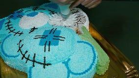 Confectioner decorates a delicious cake stock video footage