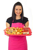 Confectioner female offering cakes Stock Image