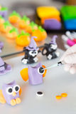 Confectioner with figures of halloween. Confectioner working on the figures of Halloween with fondant paste Royalty Free Stock Image