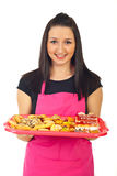 Confectioner holding cookies Royalty Free Stock Photo