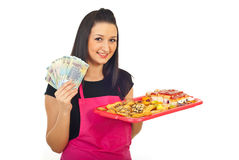 Confectioner holding money Royalty Free Stock Photo