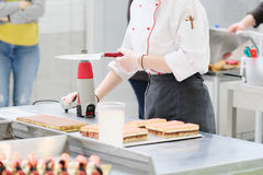 Confectioner makes cakes Stock Image