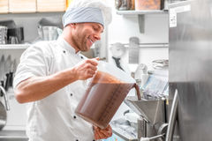 Confectioner making ice cream Stock Photography