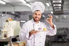 The confectioner is preparing a cake in the kitchen of the pastr Royalty Free Stock Photography