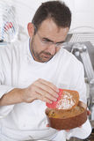 Confectioner's glaze before firing. Confectioner prepares the panettone for the cooking Stock Photo