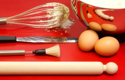 Confectioner utensils with eggs and mixture Stock Photos