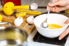 The confectioner whipped eggs Stock Image