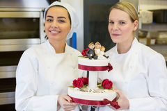 Confectioners or bakers presenting wedding cake Stock Photos