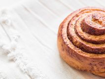 Confectionery baking. Sweet fresh soft roll bun with cinnamon on white background. Cinnabon closeup.  stock images