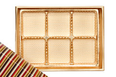 Confectionery box with partitions. Empty box from sweets of gold color on white background Royalty Free Stock Photo