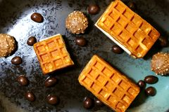 Confectionery for dessert. Wafers Viennese, candy and peanuts in royalty free stock photo