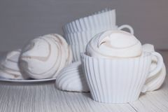 Confectionery, food, dessert. White sweet marshmallows on a light background. stock photography
