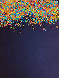 Confectionery sprinkling colored balls. Abstract sweet multi colored background with space for your text Stock Images