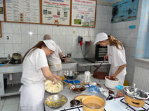 Confectionery students Stock Image
