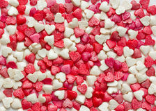 Confectionery sugar sprinkling in the form of heart Royalty Free Stock Image