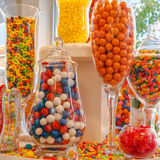 Confectionery Sweet Shop Candies. Colorful festive display of an assortment of hard candies in variously shaped jars. Square stock image