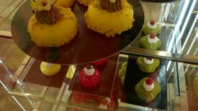 Lots of colorful and tasteful cakes in a patisserie shop. Confectionery and sweets. Lots of colorful and tasteful cakes in a patisserie shop stock video