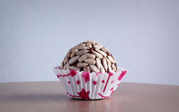 Confectionery. Traditional Indian delicacies with seeds of sunflower Stock Photos
