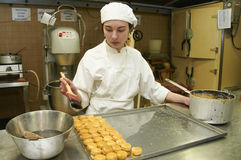 Confectionery working. With pastry and ice cream desserts Royalty Free Stock Photography