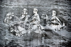 Confederate carving in stone. A carving of the confederate president Jefferson Davis and Generals Robert E. Lee and Stonewall Jackson riding at Stone Mountain Stock Images