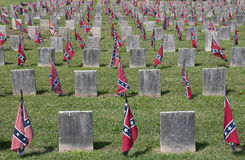 Confederate cemetery. Confederate flags marking graves in a Confederate Cemetery stock images