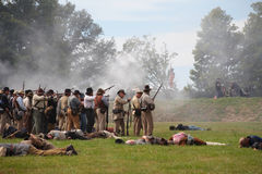 Confederate Civil War soldiers firing Royalty Free Stock Photos