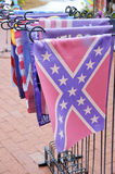 Confederate Flag. A confederate flag banner of stars and bars for sale in a Florida shop with other lawn decoration items Stock Image