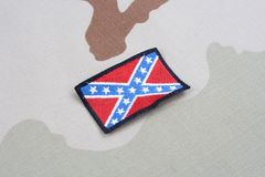 Confederate flag on camouflage uniform. Background Royalty Free Stock Photos