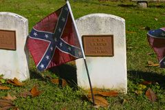 Confederate Flag on Civil War Grave. Rebel flag decorates the grave of a soldier who served in the Confederacy during the American Civil War Stock Photography