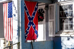 Confederate flag displayed with US Flag on front porch near window, backroads of Virginia, October 26, 2016 Stock Photography